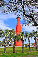 The Lighthouse at Ponce Inlet is framed by trees in this photo taken on January 19, 2014.    (Photo by Brian Cleary/www.bcpix.com)