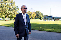 United States President Joe Biden smiles as he answers a few questions from reporters as he and first lady Dr. Jill Biden return to the White House in Washington, DC, USA, from Camp David, the presidential retreat near Thurmont, Maryland,  26 September 2021.<br /> Credit: Jim LoScalzo / Pool via CNP /MediaPunch