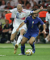 Italian midfielder (8) Gennaro Gattuso is fouled by French midfielder (10) Zinedine Zidane.  Italy defeated France on penalty kicks after leaving the score tied, 1-1, in regulation time in the FIFA World Cup final match at Olympic Stadium in Berlin, Germany, July 9, 2006.