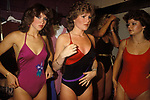 Camberley, Surrey. 1980's<br /> With their Farrah Fawcett Baywatch curled locks, Miss Camberley beauty competition contestants in their dressing room make last minute adjustment to their special look.