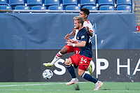 FOXBOROUGH, MA - JUNE 26: Gibran Rayo #14 of North Texas SC leaps to cross the ball near the New England Revolution II goal line during a game between North Texas SC and New England Revolution II at Gillette Stadium on June 26, 2021 in Foxborough, Massachusetts.