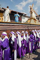 Antigua, Guatemala.  Adolescent Boys Carrying a Float in a Religious Procession during Holy Week, La Semana Santa.