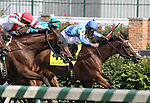Danzon with Alex Solis (outside, purple cap) runs down Happiness Is with Greta Kuntzweiler (red cap) and Acoma with Robby Albarado (blue cap) to win The Locust Grove Handicap (grIII) at Churchill Downs. 07.03.2010