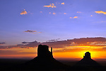 Sunrise at The Mittens in Monument Valley.