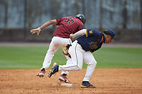 Luis DeLeon (35) of the North Carolina Central Eagles avoids the tag attempt of North Carolina A&T Aggies second baseman Alex Reyna (5) at Durham Athletic Park on April 10, 2021 in Durham, North Carolina. (Brian Westerholt/Four Seam Images)