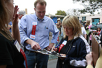 San Diego Councilman Kevin Faulconer compares notes with Ruby Houck as the two judge entrants in the 60th annual Ocean Beach Kite Festival, Craft Fair and Parade on Saturday, March 1, 2008.