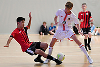Samuel Fowles of Hamilton Boys' High School and Mojtaba Sayed of Selwyn College battle for the ball during the Futsal NZ Secondary Schools Junior Boys Final between Hamilton Boys High School and Selwyn College at ASB Sports Centre, Wellington on 26 March 2021.<br /> Copyright photo: Masanori Udagawa /  www.photosport.nz