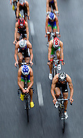 07 JUL 2012 - PARIS, FRA - Vincent Luis (Saint Genevieve Triathlon) (bottom right) leads the front pack during the bike at the elite men's French Grand Prix round during the 2012 Triathlon de Paris which was held around the Pont d'Lena, Paris, France .(PHOTO (C) 2012 NIGEL FARROW)