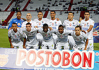 MANIZALES -COLOMBIA- 04 -12 -2013. Formacion del Once Caldas . Accion de juego entre los equipos Once Caldas contra Deportivo Pasto , encuentro de los cuadrangulares finales de la Liga Postobon jugado en el estadio Palogrande  Once Caldas team.  Action game between teams Once Caldas vs Deportivo Pasto, meeting the end-runs Postobon League played in the stadium Palogrande.Photo: VizzorImage / Santiago Osorio / Stringer