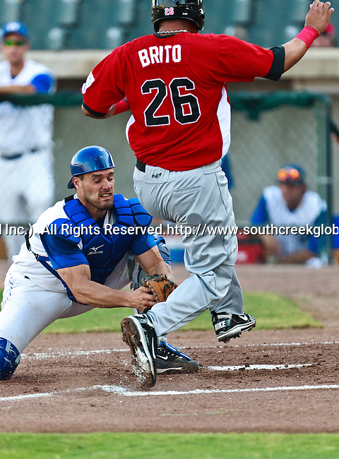 El Paso Diablos 1st Baseman Javier Brito (26) and Fort Worth Cats Catcher Kelley Gulledge (21) in action during the American Association of Independant Professional Baseball game between the El Paso Diablos and the Fort Worth Cats at the historic LaGrave Baseball Field in Fort Worth, Tx. Fort Worth defeats El Paso 10 to 9.