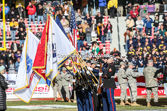 All branches of the military hold flags up during the National Anthem before the Armed Forces Bowl game between the Middle Tennessee Blue Raiders and the Navy Midshipmen at the Amon G. Carter Stadium in Fort Worth, Texas. Navy defeated Middle Tennessee 24 to 6.