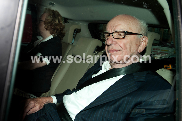 **ALL ROUND PICTURES FROM SOLARPIX.COM**                                             **NO UK NEWSPAPER PUBLICATION**.**UK MAGAZINE & SUPPLEMENT PUBLICATION ONLY** AND NO PUBLICATION IN AUSTRALIA, BELGIUM, FRANCE, GERMANY, ITALY, SCANDINAVIA AND USA**                                                                                  Caption: Rupert Murdoch leaves the News International Offices in Wapping, London this evening after News Corp abandoned a 7.8 billion-pound ($12.5 billion) bid for full control of British Sky Broadcasting Group Plc, in the wake of the current phone hacking scandal that has already brought down one of his newspapers. London, UK 2011.                                                                             This pic: Rupert Murdoch                                                                                             JOB REF: 13704 SFE       DATE: 13_07_2011                                                           **MUST CREDIT SOLARPIX.COM OR DOUBLE FEE WILL BE CHARGED**                                                                      **MUST AGREE FEE BEFORE ONLINE USAGE**                               **CALL US ON: +34 952 811 768 or LOW RATE FROM UK 0844 617 7637**