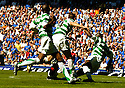 21/08/2005         Copyright Pic : James Stewart.File Name : jspa37 rangers v celtic.BOBO BALDE'S CHALLENGE ON BARRY FERGUSON WHICH HAS ALL BUT RULED HIM OUT OF THE CHAMPIONS LEAGUE QUALIFIER AGAINST FAMAGUSTA.... .Payments to :.James Stewart Photo Agency 19 Carronlea Drive, Falkirk. FK2 8DN      Vat Reg No. 607 6932 25.Office     : +44 (0)1324 570906     .Mobile   : +44 (0)7721 416997.Fax         : +44 (0)1324 570906.E-mail  :  jim@jspa.co.uk.If you require further information then contact Jim Stewart on any of the numbers above.........