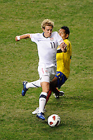 Stuart Holden (11) of the United States (USA) is marked by John Javier Restrepo (21) of Colombia (COL). The men's national teams of the United States (USA) and Colombia (COL) played to a 0-0 tie during an international friendly at PPL Park in Chester, PA, on October 12, 2010.