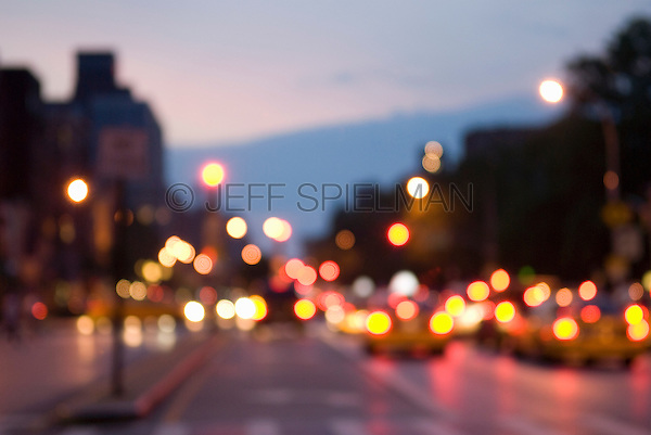 Defocused Lower Manhattan  Street Scene at Dusk, Houston Street, New York City, New York State, USA<br /> <br /> AVAILABLE SOON FOR LICENSING FROM GETTY IMAGES.  I'll post the Getty Images ID# as soon as it's available