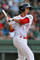 Shortstop Javier Guerra (31) of the Greenville Drive hits a double in the first inning of a game against the Augusta GreenJackets on Thursday, July 16, 2015, at Fluor Field at the West End in Greenville, South Carolina. Guerra is the No. 13 prospect of the Boston Red Sox, according to Baseball America. Greenville won, 11-5. (Tom Priddy/Four Seam Images)