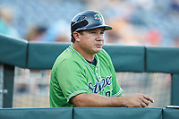 Gwinnett Stripers coach Einar Diaz (28) watches the action from the dugout during the game against the Scranton/Wilkes-Barre RailRiders at Coolray Field on August 16, 2019 in Lawrenceville, Georgia. The Stripers defeated the RailRiders 5-2. (Brian Westerholt/Four Seam Images)