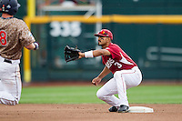 Arkansas Razorbacks shortstop Michael Bernal (3) waits for the catchers throw at second base against the Virginia Cavaliers in Game 1 of the NCAA College World Series on June 13, 2015 at TD Ameritrade Park in Omaha, Nebraska. Virginia defeated Arkansas 5-3. (Andrew Woolley/Four Seam Images)