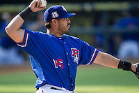 Round Rock Express designated hitter Geovany Soto (16) warms up the pitcher in between innings during the first game of a Pacific Coast League doubleheader against the Memphis Redbirds on August 3, 2014 at the Dell Diamond in Round Rock, Texas. The Redbirds defeated the Express 4-0. (Andrew Woolley/Four Seam Images)