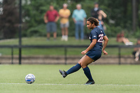 NEWTON, MA - AUGUST 29: Yasmin Rosewell #28 of University of Connecticut passes the ball during a game between University of Connecticut and Boston College at Newton Campus Soccer Field on August 29, 2021 in Newton, Massachusetts.