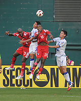 El Salvador Victor Turcios (5)  heads the ball against Panama Luis Tejada (18) right and Felipe Baloy (230 left. Panama defeated El Salvador in penalty kicks 5-3 in the quaterfinals for the 2011 CONCACAF Gold Cup , at RFK Stadium, Sunday June 19, 2011.