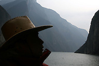 CHINA. Chongqing Province.  A man looks out onto the 3 Gorges. The flooding of the three Gorges, by damming the Yangtze near the town of YiChang, has remained a controversial subject due to the negative environmental consequences and the displacement of millions of people in the flood plain. The Yangtze River however is reported to be at its lowest level in 150 years as a result of a country-wide drought. It is China's longest river and the third longest in the world. Originating in Tibet, the river flows for 3,964 miles (6,380km) through central China into the East China Sea at Shanghai.  2008.