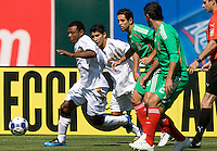 05 July 2009:  Samuel Wilson of Nicaragua dribbles the ball away from Mexico defenders during the game at Oakland-Alameda County Coliseum in Oakland, California.    Mexico defeated Nicaragua, 2-0.