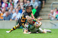 Mike Brown of Harlequins runs in a try despite the challenge of Nic Berry of London Wasps during the Aviva Premiership match between London Wasps and Harlequins at Twickenham on Saturday 1st September 2012 (Photo by Rob Munro)