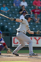 Salt Lake Bees shortstop Andrew Romine (7) follows through on his swing during the Pacific Coast League baseball game against the Round Rock Express on August 10, 2013 at the Dell Diamond in Round Rock, Texas. Round Rock defeated Salt Lake 9-6. (Andrew Woolley/Four Seam Images)