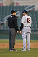 Hickory Crawdads manager Steve Mintz (13) argues a call with first base umpire Matt Carlyon during the game against the Kannapolis Intimidators at Kannapolis Intimidators Stadium on April 7, 2016 in Kannapolis, North Carolina.  The Crawdads defeated the Intimidators 5-1.  (Brian Westerholt/Four Seam Images)