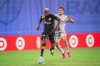 LAKE BUENA VISTA, FL - JULY 16: Gyasi Zardes #11 of the Columbus Crew SC dribbles the ball during a game between New York Red Bulls and Columbus Crew at Wide World of Sports on July 16, 2020 in Lake Buena Vista, Florida.
