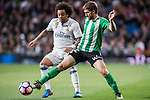 Marcelo Vieira Da Silva of Real Madrid battles for the ball with Darko Brasanac of Real Betis during their La Liga match between Real Madrid and Real Betis at the Santiago Bernabeu Stadium on 12 March 2017 in Madrid, Spain. Photo by Diego Gonzalez Souto / Power Sport Images