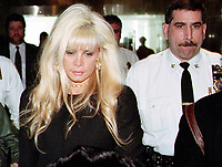 "020100_Queens New York_Victoria Gotti Agnello, daughter of jailed crime boss John Gotti, & wife of alledged Gambino capo Carmine Agnello, leaves Supreme Court in Kew Gardens after bail hearing to release her husband  who was being held  on a charge of of ""enterprise racketeering""  with a 2 million  dollar bail. (Photo©Neil Schneider)"
