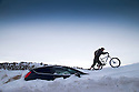 01/02/15<br /> <br /> After more overnight snow a cyclist struggles to pass a car buried in snowdrifts near Castleton in the Derbyshire Peak District.<br /> <br /> All Rights Reserved - F Stop Press.  www.fstoppress.com. Tel: +44 (0)1335 418629 +44(0)7765 242650