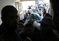 "Gaza.15.01.2008Palestinian Hamas supporters carry the body of Hussam Mahmud Al Zahar, after he was killed during Israeli raid in al Zitun area in the east of Gaza City, 15 January 2008. 16 Hamas militants were killed during an Israeli raid in the east of Gaza City, one of them was Hussam Mahmud al Zahar the son of senior Hamas leader Dr Mahmud al Zahar. .""photo by Fady Adwan"