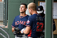 AJ Graffanino (16) of the Rome Braves, left, waits at the bat rack with Greyson Jenista (23) for a game to begin against the Greenville Drive on Wednesday, July 11, 2018, at Fluor Field at the West End in Greenville, South Carolina. The two are among the Atlanta Braves' top 2018 draft picks. (Tom Priddy/Four Seam Images)