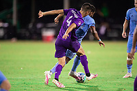 LAKE BUENA VISTA, FL - JULY 14: Joao Moutinho #4 of Orlando City SC battles for the ball during a game between Orlando City SC and New York City FC at Wide World of Sports on July 14, 2020 in Lake Buena Vista, Florida.