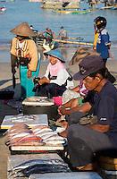 Jimbaran Beach, Bali, Indonesia.  Selling Fish on the Beach, early Morning.