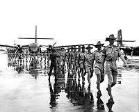 A contingent of the Royal Australian Air Force arrives at Tan Son Nhut Airport, Saigon, to work with the South Vietnamese and U.S. Air Forces in transporting soldiers and supplies to combat areas in South Viet-nam.  August 10, 1964.  Army<br /> NARA FILE #:  306-PSC-64-5382<br /> WAR & CONFLICT BOOK #:  393