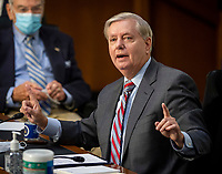 United States Senator Lindsey Graham (Republican of South  Carolina), Chairman, US Senate Judiciary Committee makes remarks as the US Senate Judiciary committee continues its hearing on the confirmation of Judge Amy Coney Barrett to the Supreme Court, in Washington, DC on October 15, 2020<br /> Credit: Bill O'Leary / Pool via CNP /MediaPunch