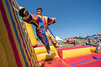 NWA Democrat-Gazette/J.T. WAMPLER Anthony Olivera of Rogers leaps onto a Velcro Wall Sunday Oct. 2, 2016 the Northwest Arkansas Hispanic Heritage Festival at Mae Farm in Fayetteville. The festival is a program of the Fayetteville Chamber of Commerce. The festival is in its fourth year and celebrates Hispanic Heritage Month that runs Sept. 15-Oct. 15.