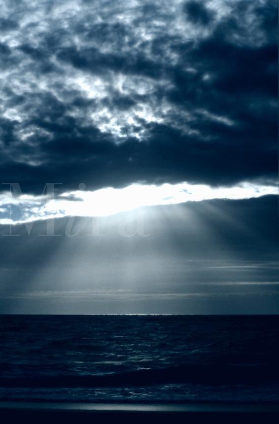Dramatic lightrays through ocean clouds.<br />