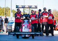 Oct 14, 2019; Concord, NC, USA; Crew members with NHRA top fuel driver Doug Kalitta during the Carolina Nationals at zMax Dragway. Mandatory Credit: Mark J. Rebilas-USA TODAY Sports