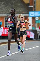 3rd October 2021; London, England: The Virgin Money 2021 London Marathon: Charlotte Purdue of Great Britain crossing Narrow Street Swing Bridge, Limehouse Basin between mile 14 and 15.