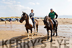 Fiadhna Tagney from Beaufort and Eric Flynn from Tralee out with their horses on Inch Beach on Sunday.