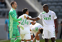 LOS ANGELES, CA - APRIL 17: Brad Stuver #41 and Jhohan Romaña #3 of Austin FC exchange a few words with each other during a game between Austin FC and Los Angeles FC at Banc of California Stadium on April 17, 2021 in Los Angeles, California.