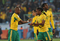 South Africa defender Tsepo Masilela and midfielder Siphiwe Tshabalala exchange good luck wishes just before kickoff. Uruguay defeated South Africa, 2-0, in both teams' second match of play in Group A of the 2010 FIFA World Cup. The match was played at Loftus Versfeld in Pretoria, South Africa June 16th.