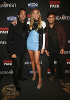 HOLLYWOOD, CA - OCTOBER 12: Samuel Gonzalez Jr., Rachel Hilbert, Michael Lombardi, at the 21st Screamfest Opening Night Screening Of The Retaliators at Mann Chinese 6 Theatre in Hollywood, California on October 12, 2021. Credit: Faye Sadou/MediaPunch