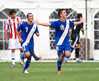 Manuel Leon (15) of Guatemala celebrates his goal with teammate Marco Ciani (7) during the game at RFK Stadium in Washington, DC.  Guatemala tied Paraguay, 3-3.