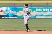 Glendale Desert Dogs second baseman Steve Wilkerson (12), of the Baltimore Orioles organization, throws to first base during an Arizona Fall League game against the Peoria Javelinas at Peoria Sports Complex on October 22, 2018 in Peoria, Arizona. Glendale defeated Peoria 6-2. (Zachary Lucy/Four Seam Images)